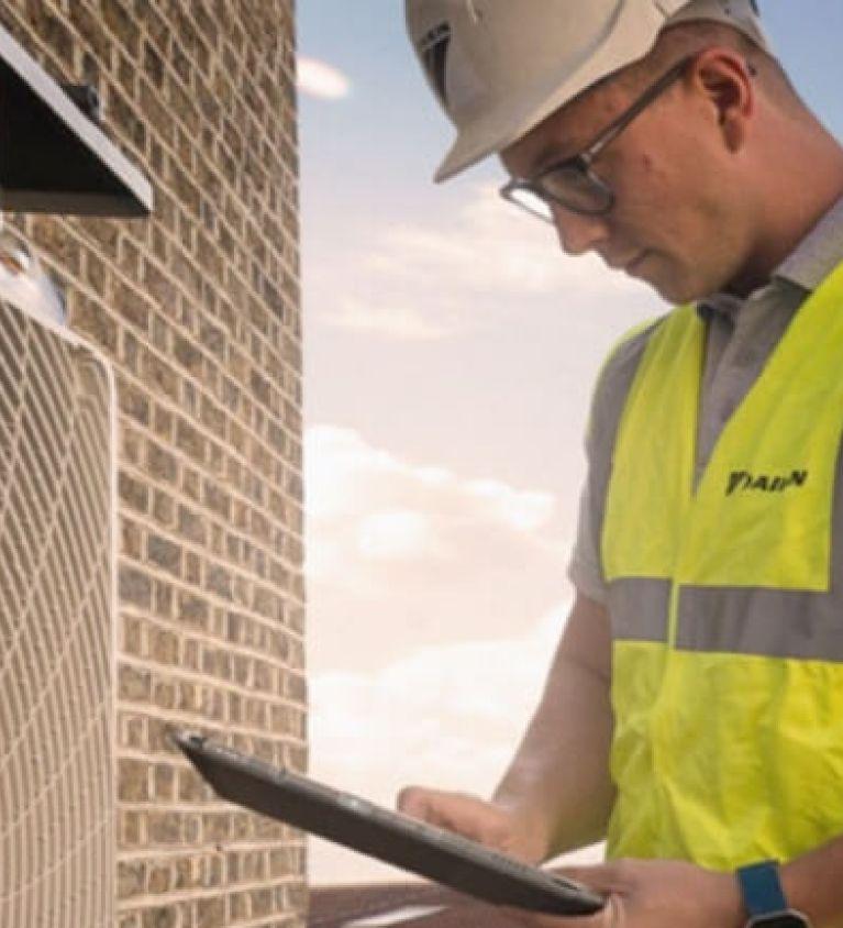 hybrid heat pump being inspected