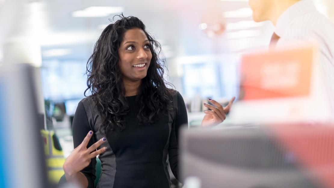 Lady smiling inside an office space