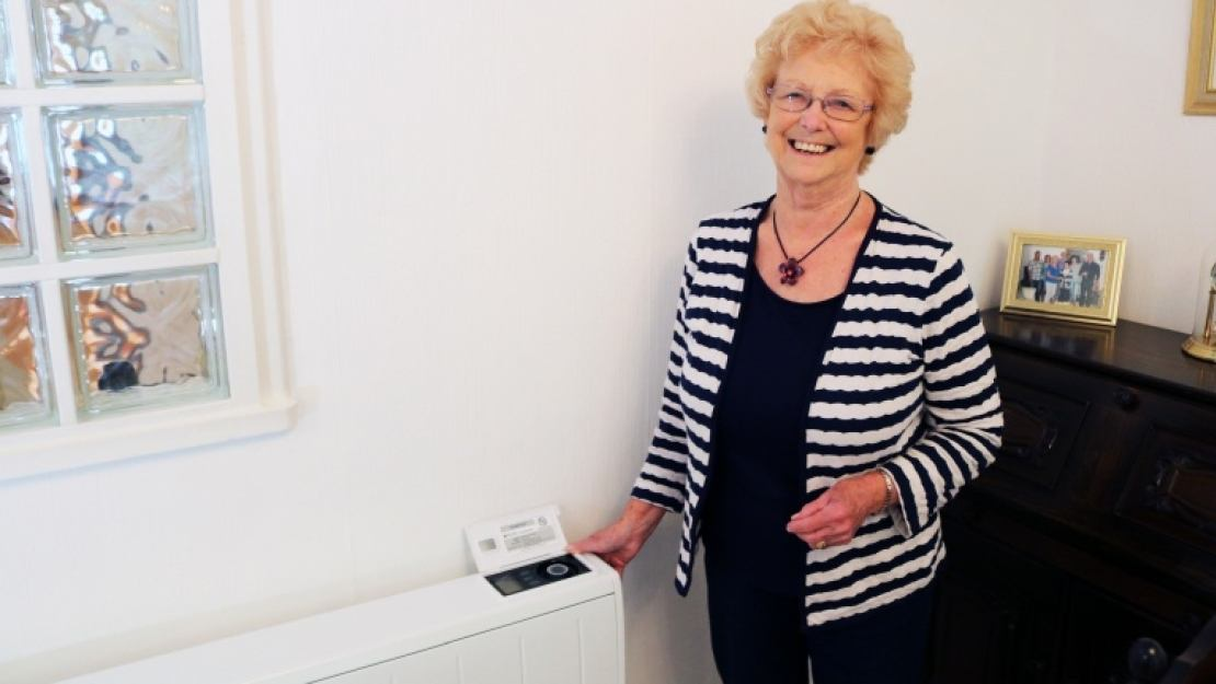 Dimplex Quantum storage heater installed in home with happy elderly lady