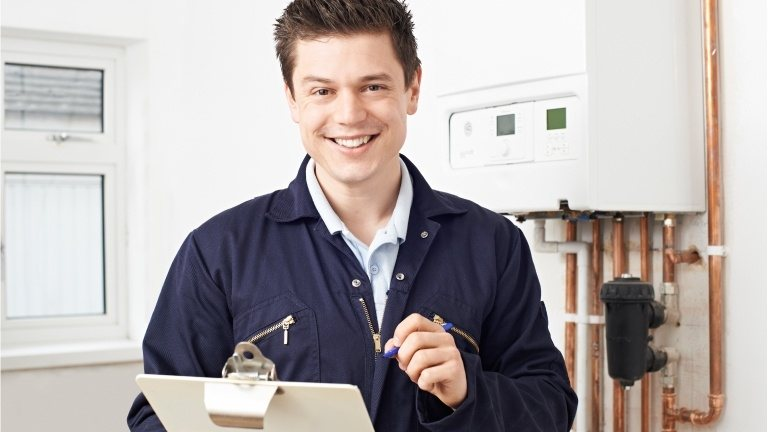 Boiler service engineer with checklist