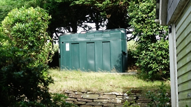 domestic heating oil storage tank in a garden