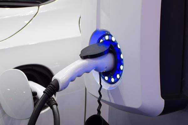 electric vehicle charging station at home with electric car