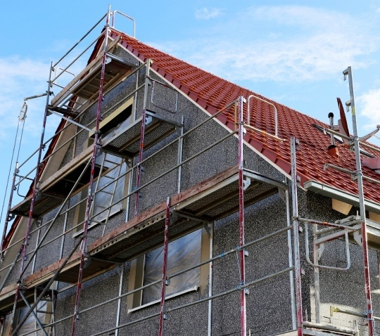 external wall insulation being installed on a house