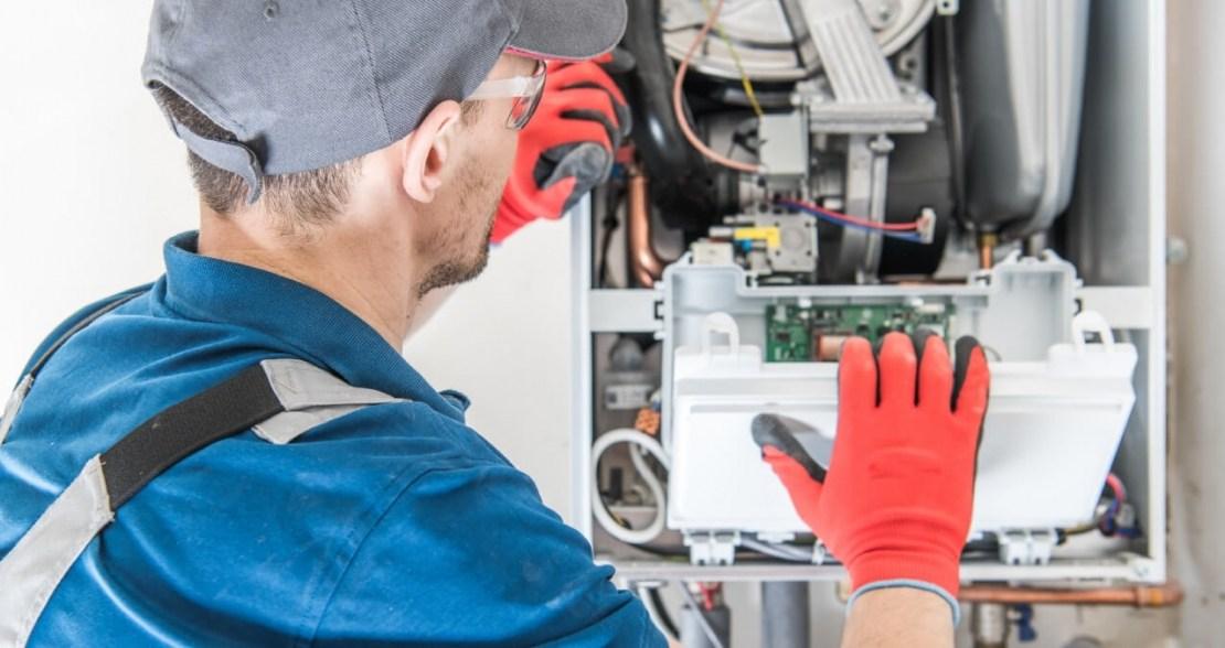 Gas Safe engineer servicing a gas boiler