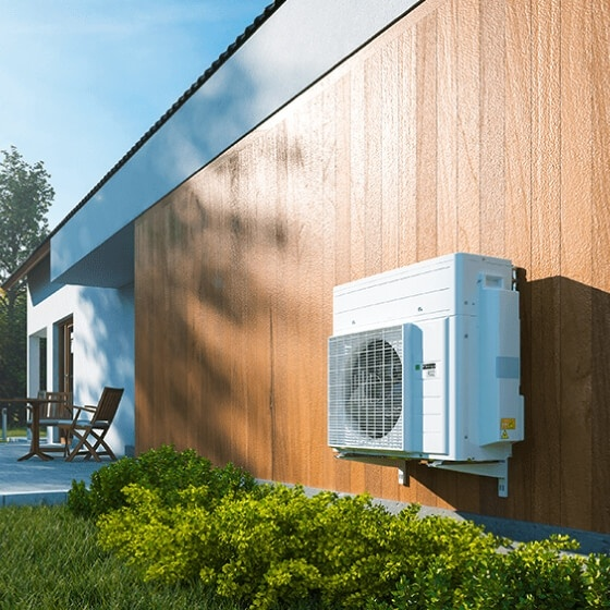 hybrid heat pump on the side of a modern house