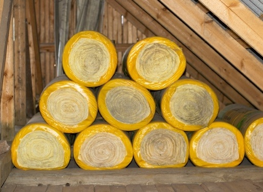 rolls of loft insulation ready to install in an attic