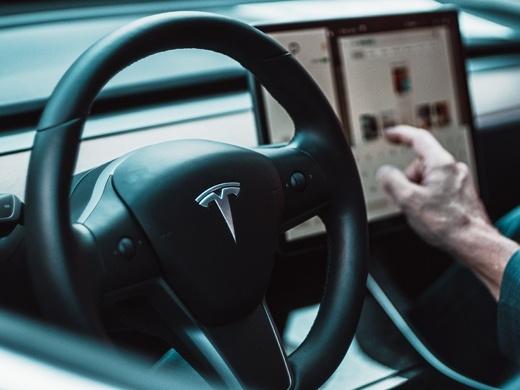 tesla steering wheel and dashboard