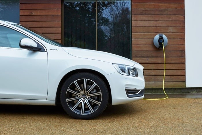 Electric car (EV) plugged into a Pod Point home charger