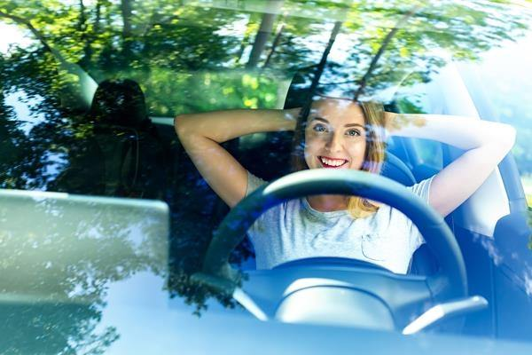 Young woman driver in electric car in countryside