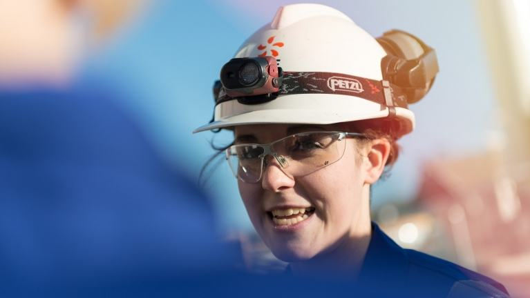 Female engineer wearing white hard hat