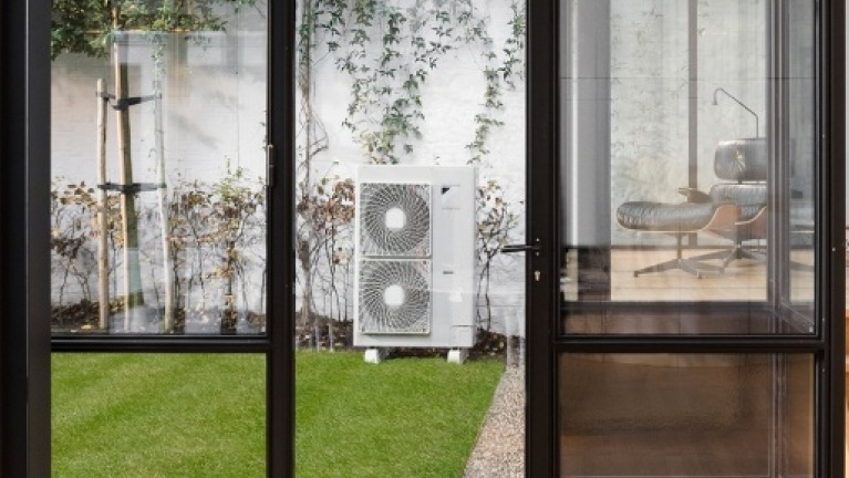 air source heat pump in modern garden