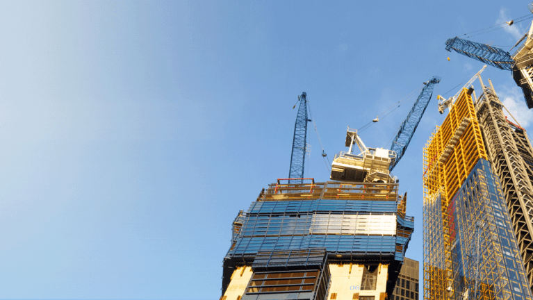 Cranes by office block