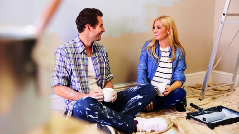 Home improvement loans - Couple doing DIY having a tea break