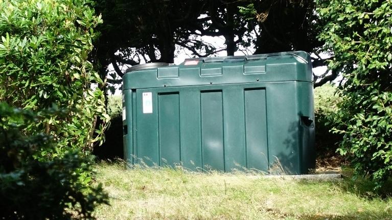 domestic plastic oil storage tank in garden