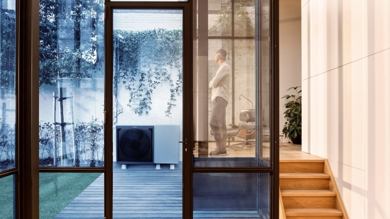 Cosy home with Air Source Heat Pump outside
