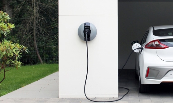Pod Point Solo home charger on a white wall