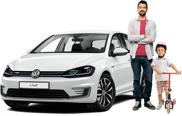 Man with his son standing in front of a VW e-Golf electric car