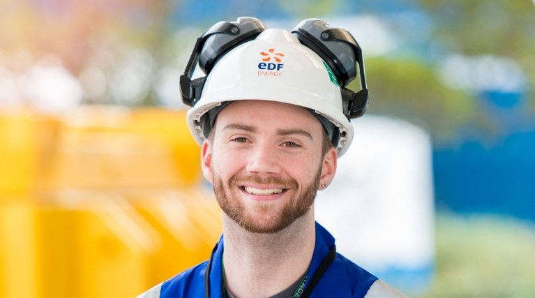 Male engineer in white hard hat smiling