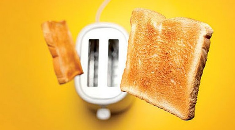 two pieces of toast shoot out of a toaster on an orange background