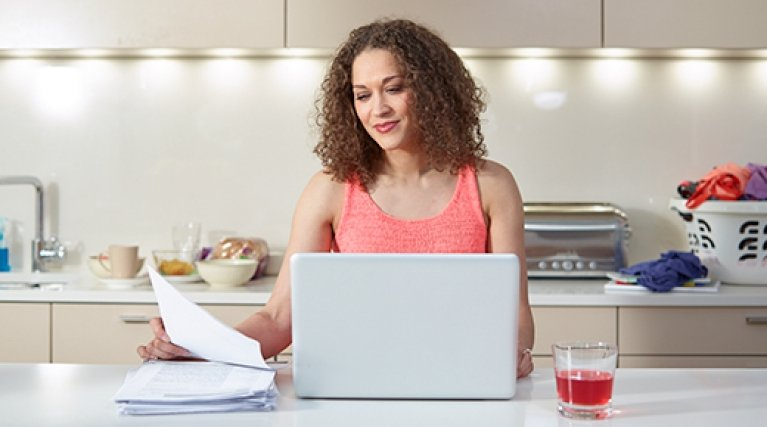 Lady with laptop in kitchen