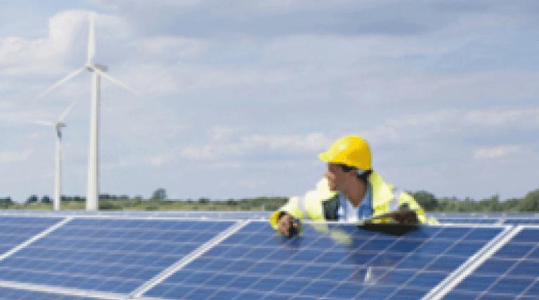 Men working on solar panel