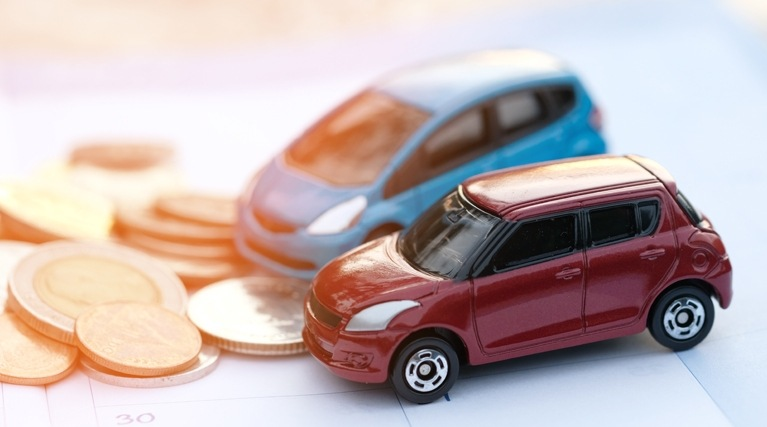 electric car tax model cars and coins