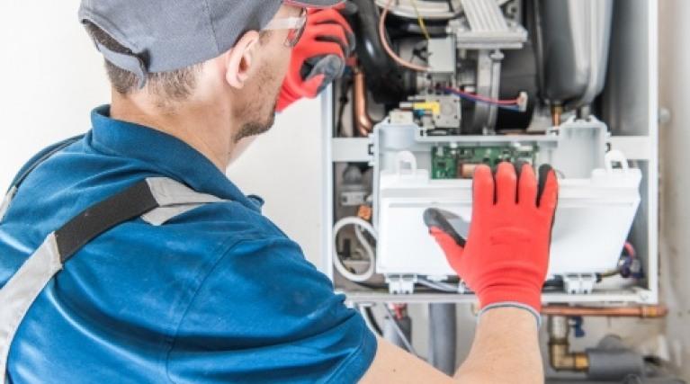 Gas Safe engineer repairing a gas boiler