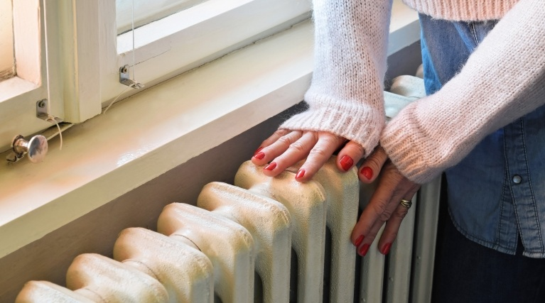 Hands on a radiator - Energy efficient heaters