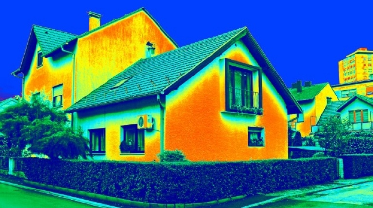 partially insulated house showing heat loss