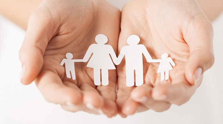 Supporting Our Customers - Hands holding paper cut-out family