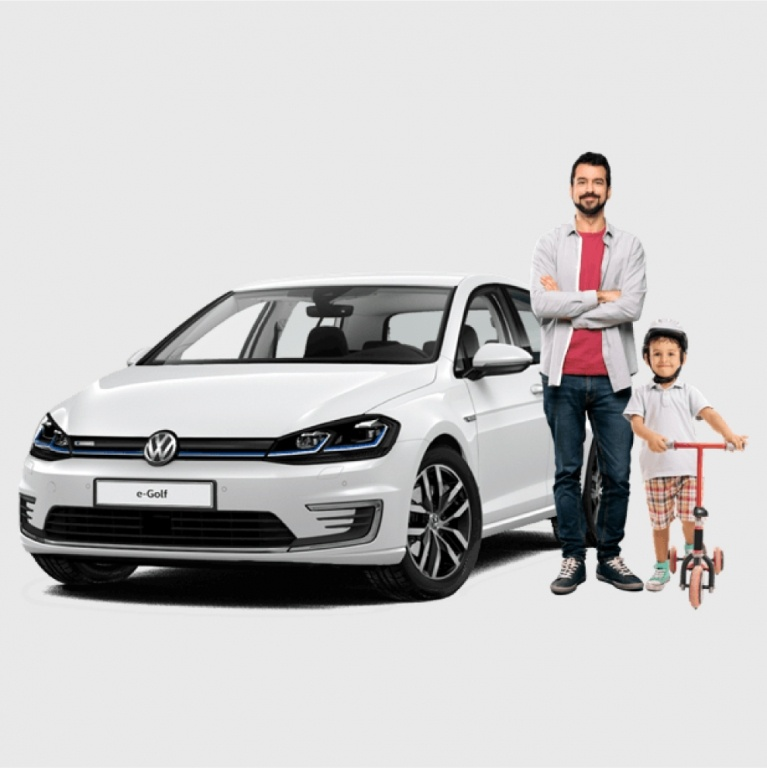 Father and son next to a VW e-Golf electric car