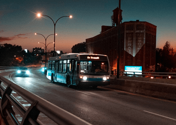 Electric bus on the road at night
