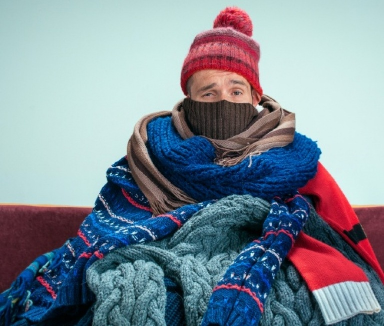 man in cold home with broken heating