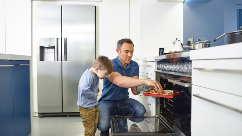 Man and boy in the kitchen baking