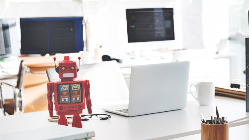 Robot next to a laptop