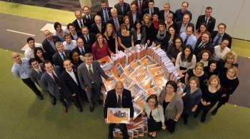 EDF Energy staff gathered around a stack of document files