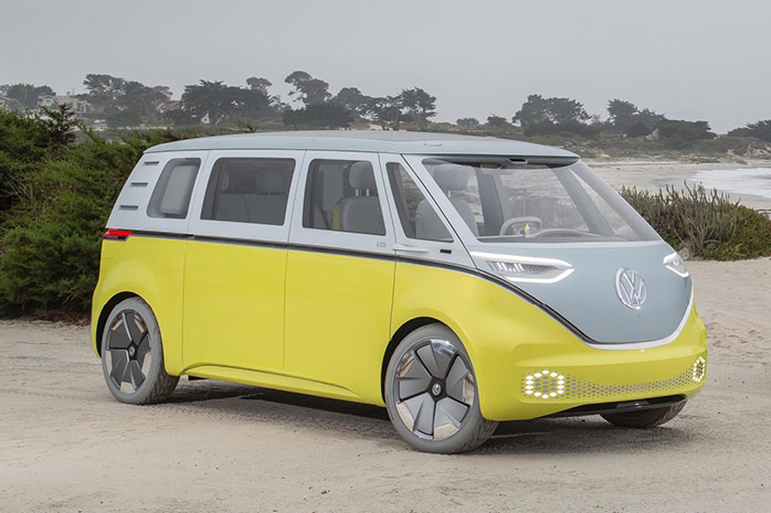 VW iD Buzz in grey and yellow on the beach