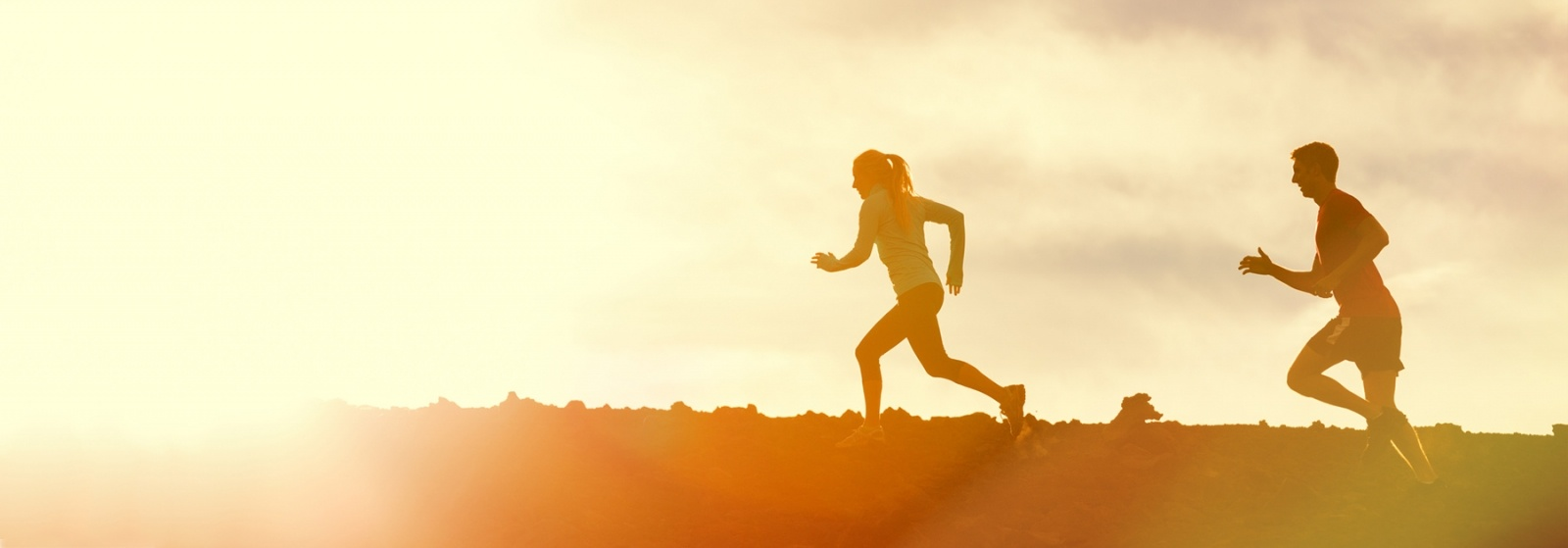 Person running on a hill top