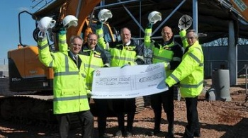 EDF Energy engineers handing over £2 million cheque for Bridgwater College